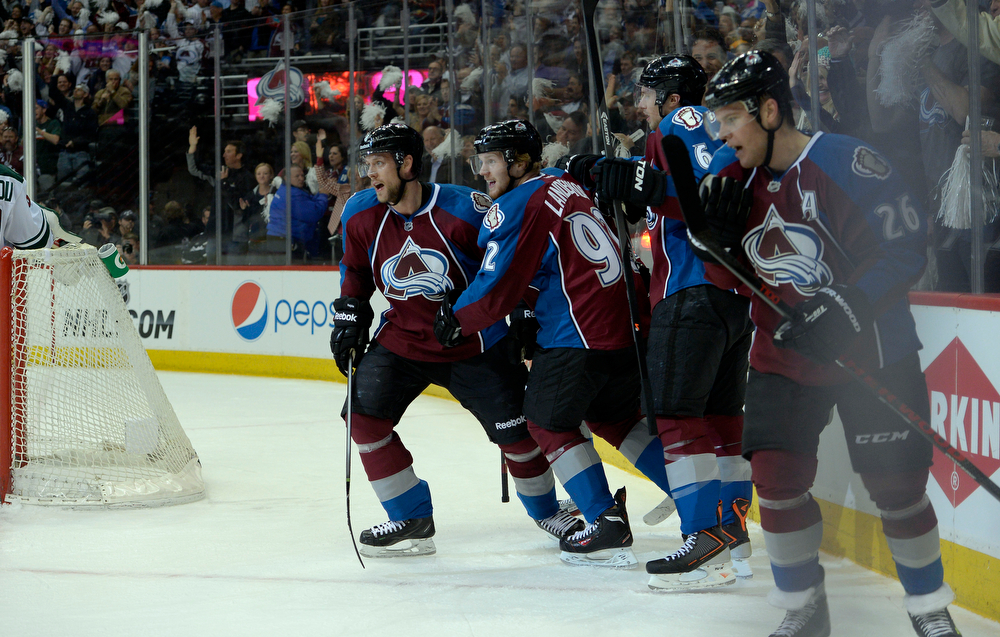 . Gabriel Landeskog (92) of the Colorado Avalanche celebrates with teammates after scoring the first goal of the game during the first quarter of action. The Colorado Avalanche hosted the Minnesota Wild for the first playoff game at the Pepsi Center on Thursday, April 17, 2014. (Photo by John Leyba/The Denver Post)