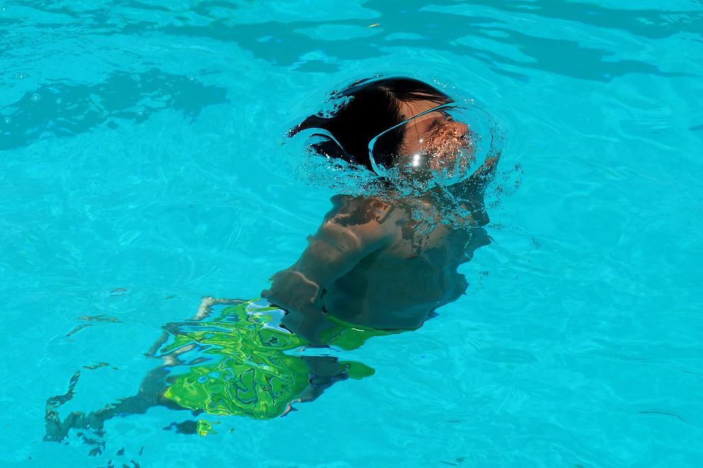 . Jose Orellana, 13, surfaces at Lanark Park pool in Canoga Park, Saturday, June 14, 2014. (Photo by Michael Owen Baker/Los Angeles Daily News)