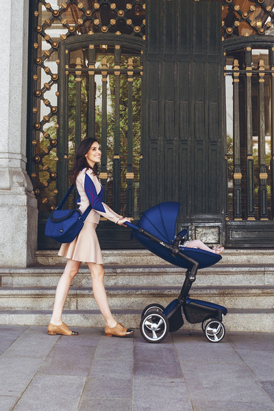 Mima_Xari_Lifestyle_Royal_Blue_Black_Chassis_Mum_Walking_With_Pushchair_Side_View_BGmask_Adam.jpg