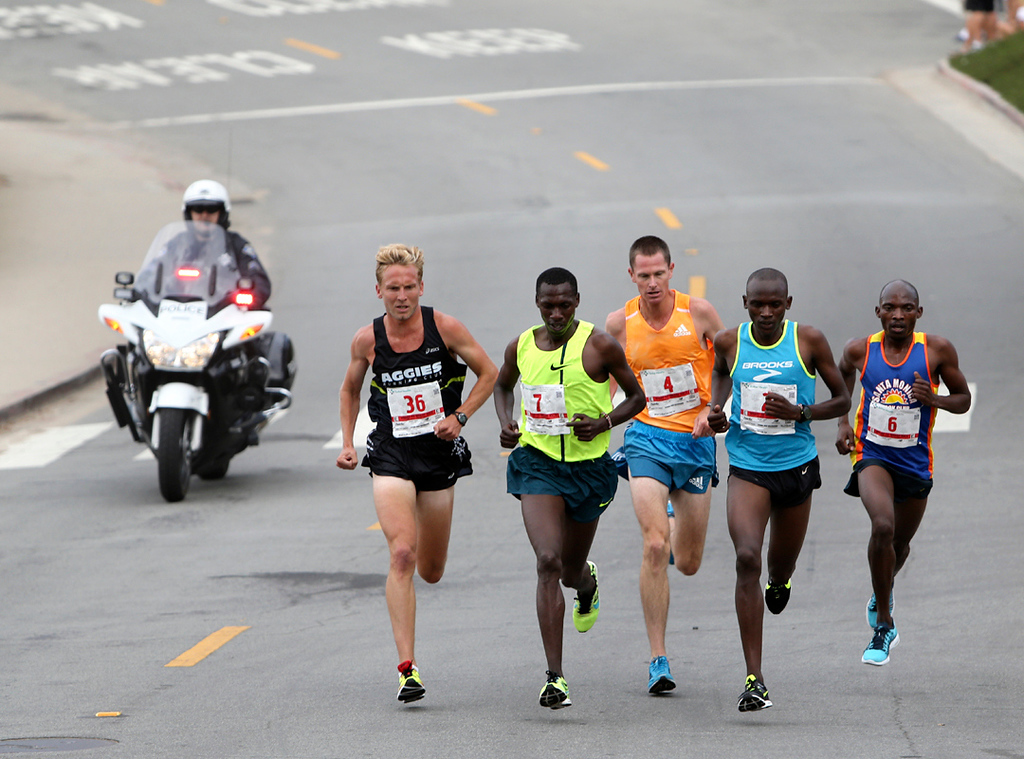 . Wharf to Wharf elite runners hold a steady pace as they compete in the 42nd annual race. (Kevin Johnson -- Santa Cruz Sentinel)