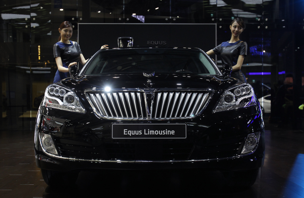. Models pose next to a Hyundai Equus Limousine at the Seoul Motor Show 2013 on March 28, 2013 in Goyang, South Korea. The Seoul Motor Show 2013 will be held in March 29-April 7, featuring state-of-the-art technologies and concept cars from global automakers. The show is its ninth since the first one was held in 1995. About 384 companies from 14 countries, including auto parts manufacturers and tire makers, will set up booths to showcase trends in their respective industries, and to promote their latest products during the show.  (Photo by Chung Sung-Jun/Getty Images)