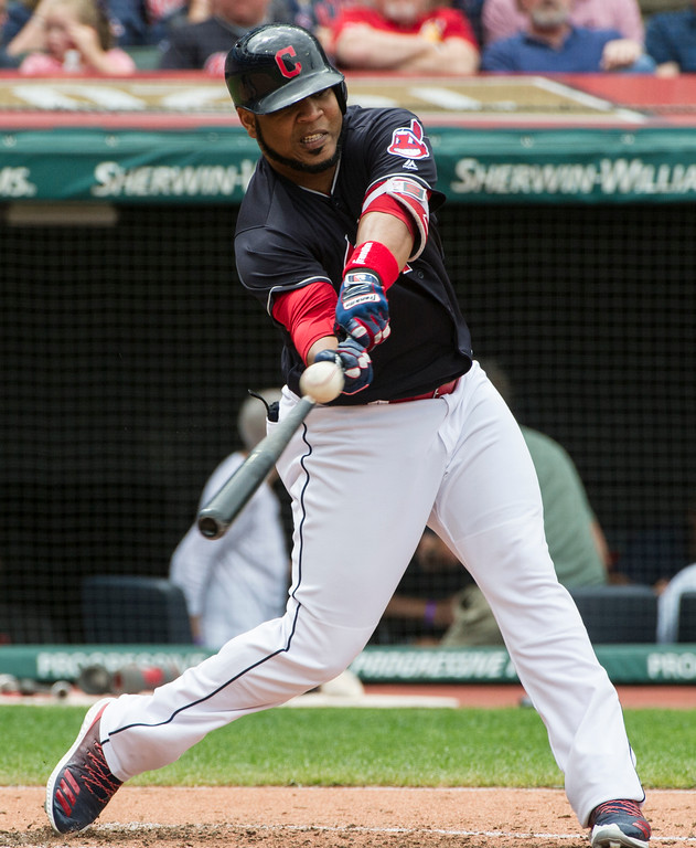. Cleveland Indians\' Edwin Encarnacion hits an RBI single off Minnesota Twins starting pitcher Jake Odorizzi during the fourth inning of a baseball game in Cleveland, Thursday, Aug. 30, 2018. (AP Photo/Phil Long)
