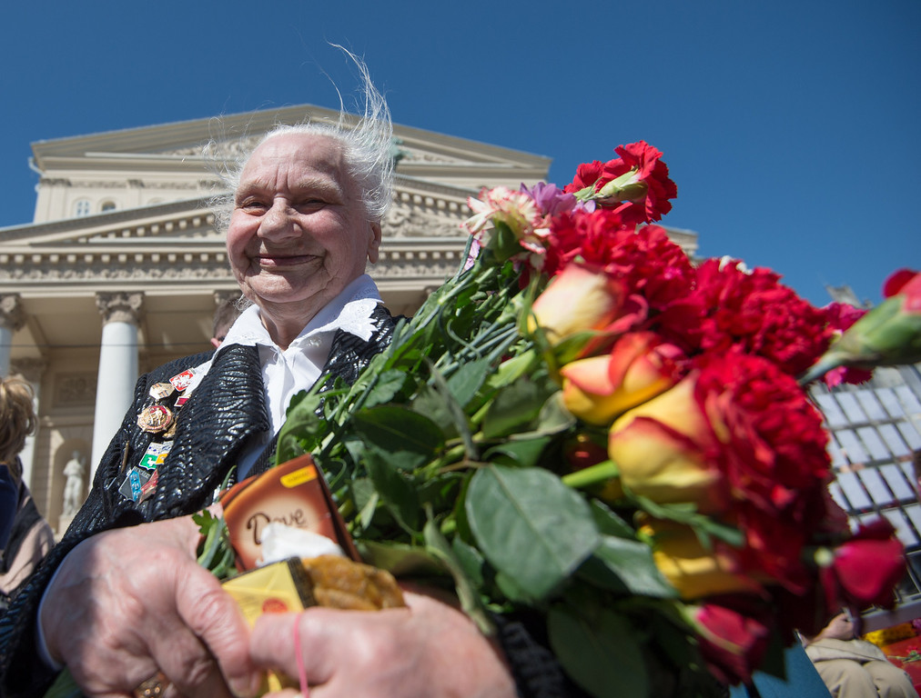 . A World War II female veteran carry flowers during Victory Day celebrations in Moscow, on May 9, 2014. Russia and ex-Soviet republics marked today the 69 years since the Soviet victory over Nazi Germany in the World War II. AFP PHOTO / ANATOLY  TANIN/AFP/Getty Images