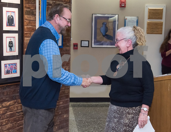 11/21/17 Wesley Bunnell | Staff Berlin held their Swearing-In Ceremony for elected officials at Berlin Town Hall on Tuesday evening. John Frink from the Board of Assessment Appeals John Frink shakes hands with Town Clerk Kate Wall after being sworn in.