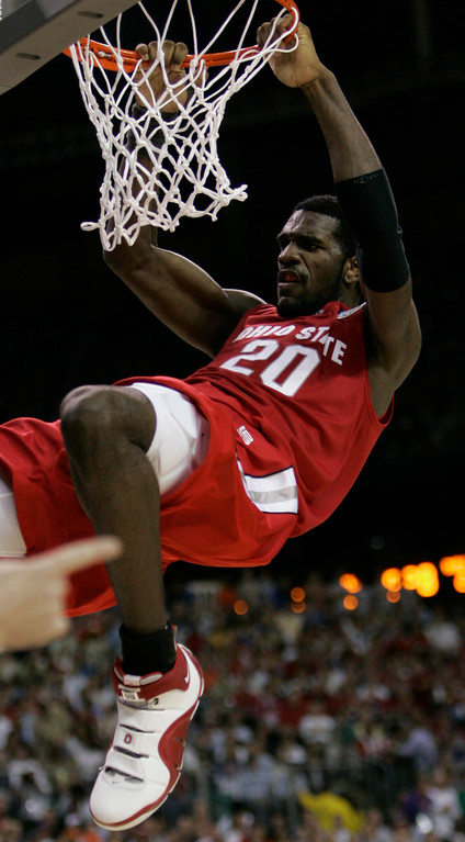 . Ohio State center Greg Oden hangs off the rim after scoring during the second half of the Final Four basketball championship game against Florida at Georgia Dome in Atlanta, Monday, April 2, 2007. (AP Photo/Eric Gay)
