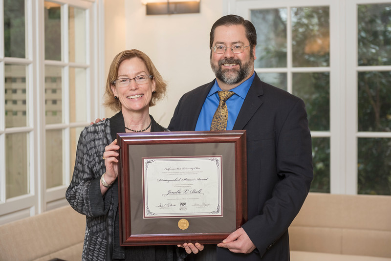 College of Natural Sciences Distinguished Alumni Jenelle L. Ball (BS, Chemistry, 1982) (left) receives recognition by David Hassenzahl (Dean, NS) (right) on Friday, March 24, 2017 in Chico, Calif. (Jason Halley/University Photographer)