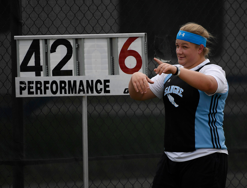 """. LAKEWOOD, CO - May 20: Jenna McKinley, Sangre de Cristo High School, poses next to a sign that posted her record setting shot put distance of 42\' 6\"""", a new state record in the girls 1A shot put at the Colorado State High School Track and Field Championships at Jeffco Stadium May 20, 2016. (Photo by Andy Cross/The Denver Post)"""