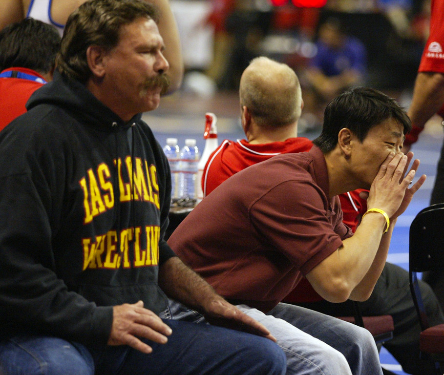 . Las Lomas wrestling coaches Kurt Billingsley and David Yi, from left, shout instructions to Las Lomas\'s Dylan Walsh in his 285-pound second round match during the California Interscholastic Federation wrestling championships in Bakersfield, Calif., on Friday, March 1, 2013. (Anda Chu/Staff)