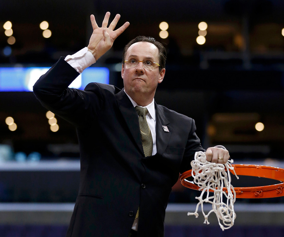 . Wichita State Shockers head coach Gregg Marshall signals that his team is going to the Final Four after defeating the Ohio State Buckeyes in their West Regional NCAA men\'s basketball game in Los Angeles, California March 30, 2013. REUTERS/Danny Moloshok