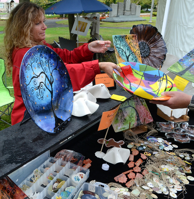 . Artist Wendy Shupinski displays some of her works during the 26th Annual Lansdale Festival of the Arts in Memorial Park on Saturday August 23,2014. Photo by Mark C Psoras/The Reporter
