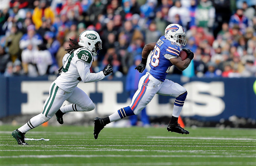 Description of . New York Jets cornerback Kyle Wilson (20) tries to run down Buffalo Bills running back C.J. Spiller (28) during the first half an NFL football game on Sunday, Dec. 30, 2012, in Orchard Park, N.Y. (AP Photo/Mel Evans)