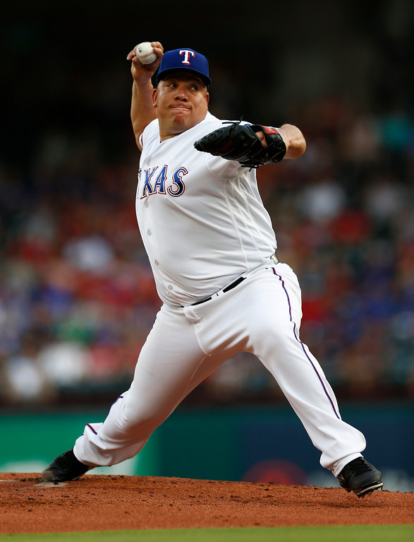 . Texas Rangers starting pitcher Bartolo Colon delivers a pitch to a Cleveland Indians batter during the first inning of a baseball game, Saturday, July 21, 2018, in Arlington, Texas. (AP Photo/Jim Cowsert)