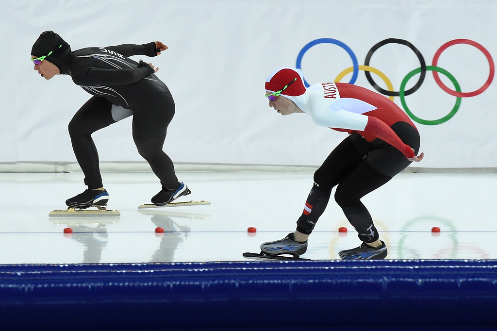 . Austria\'s Anna Rokita (R) and US Jilleanne Rookard compete in the Women\'s Speed Skating 3000m at the Adler Arena during the Sochi Winter Olympics on February 9, 2014.   DAMIEN MEYER/AFP/Getty Images