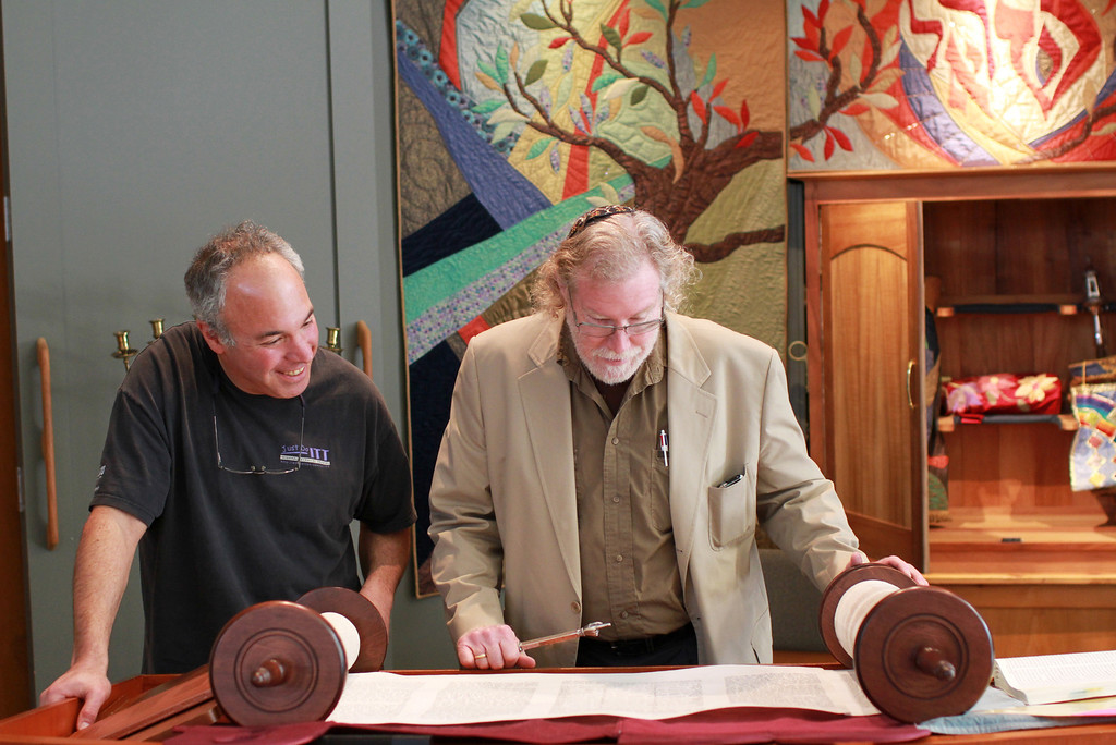 . Rabbi Ari Mark Cartun, right, and Marc Rossner, left, look at a unique Torah inside Congregation Etz Chayim in Palo Alto on Friday, Jan. 25, 2013. This Torah is one of only two in the world that was written from beginning to end by a woman. The hand-written scroll is on loan from San Francisco�s Contemporary Jewish Museum and will be read today, Saturday, Jan. 26, 2013, during morning services at the congregation.  (Kirstina Sangsahachart/ Daily News)