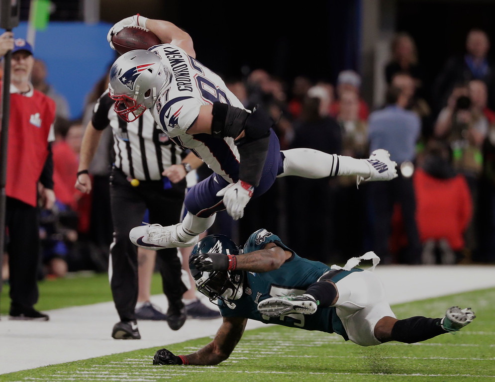 . Philadelphia Eagles cornerback Jalen Mills (31) tackles New England Patriots tight end Rob Gronkowski (87), during the second half of the NFL Super Bowl 52 football game Sunday, Feb. 4, 2018, in Minneapolis. (AP Photo/Tony Gutierrez)