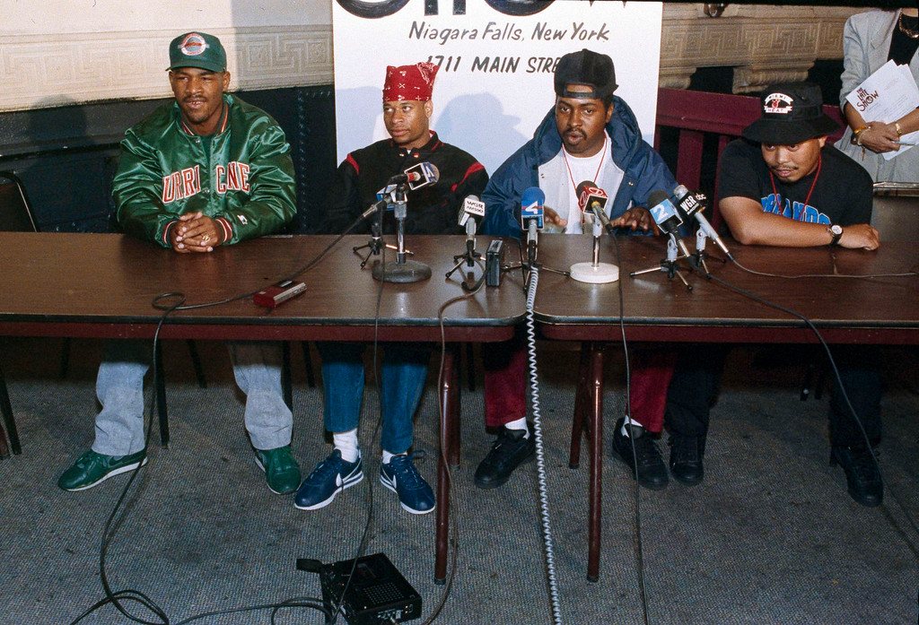 """. FILE - In this Oct. 3, 1990, file photo, 2 Live Crew member Mr. Mixx (David Hobbs), second from right, speaks to reporters at the Late Show night club in Niagara Falls, N.Y., while being joined by fellow group members, J.T. Money, left, Brother Marquis, second from left; and Fresh Kid Ice, right. Christopher Wong Won, known as Fresh Kid Ice and a founding member of the Miami hip-hop group 2 Live Crew has died Thursday, July 13, 2017, at a Veterans Affairs hospital in Miami as a result of \""""medical conditions\"""" he had suffered for several years, the group\'s manager, DJ Debo, said. He was 53.  (AP Photo/Mike Groll, File)"""