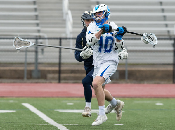 04/08/19 Wesley Bunnell | Staff Southington boys lacrosse vs Newington on Monday evening at Southington High School. Ethan Thomson (10).