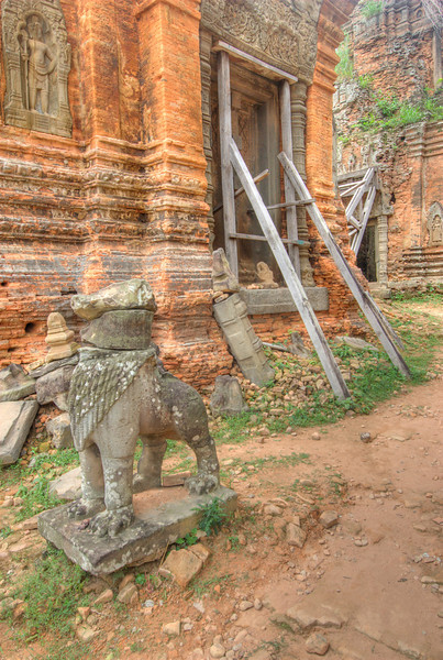 A solitary statue outside Lolie Temple in Cambodia