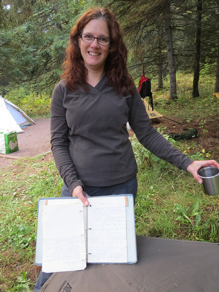 This is Kim showing off her ancient manuscript. She began writing down camp songs in this book like 35 years ago.