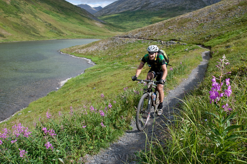 In fourth as he skirts Devil's Pass Lake, Loranty manages a smile as he nears the 80 mile mark. (2009)