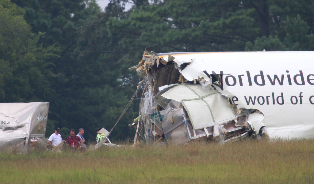 . Investigators work the scene of the UPS cargo plane that crashed Wednesday on approach to the Birmingham-Shuttlesworth International Airport Thursday, Aug. 15,  2013 in Birmingham, Ala. (AP Photo/Hal Yeager)