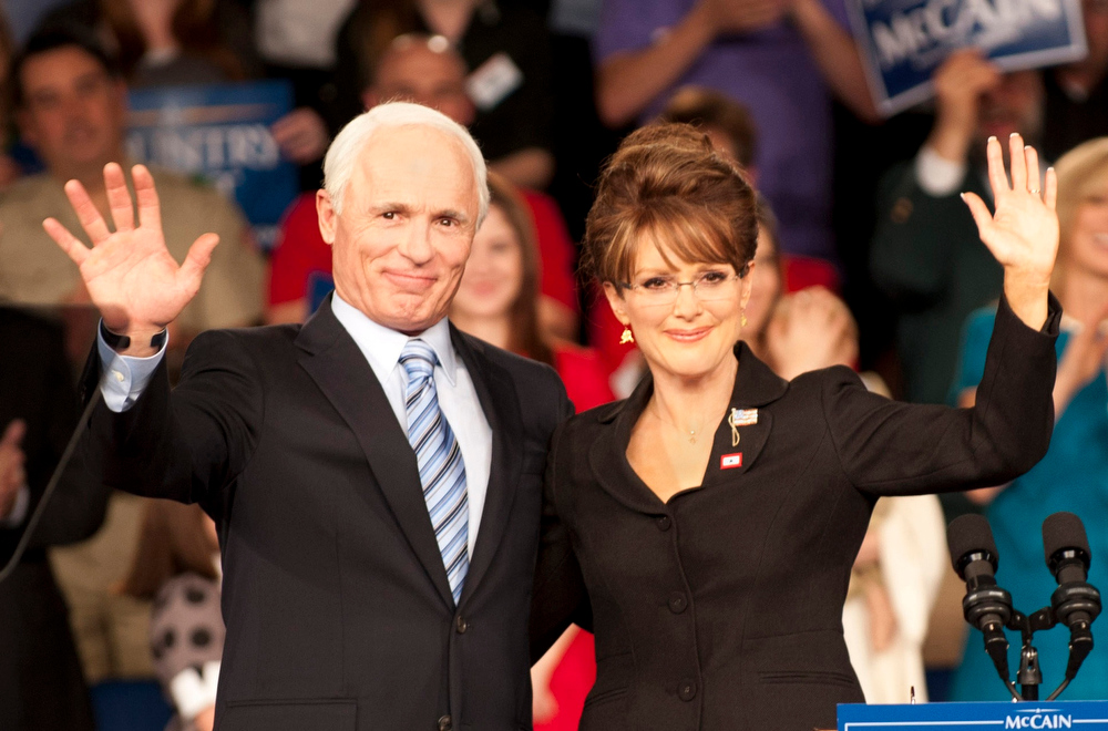 Description of . FILE - In this undated file photo released by HBO, Ed Harris portrays Arizona Sen. John McCain, left, and Julianne Moore portrays Sarah Palin, in a scene from