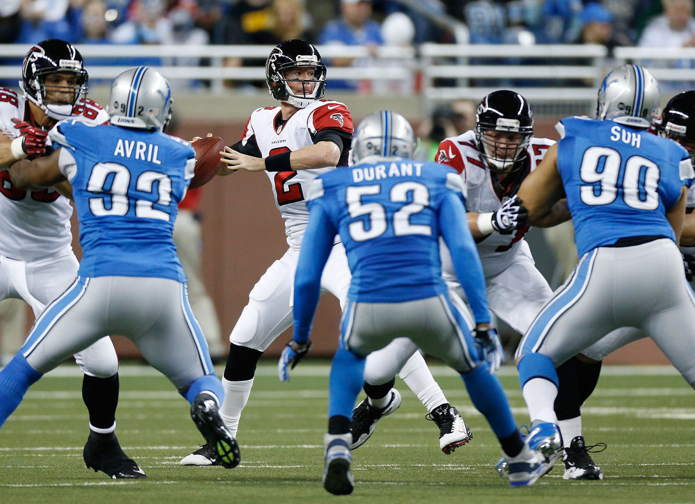 Description of . Matt Ryan #2 of the Atlanta Falcons gets ready to throw a first quarter pass while playing the Detroit Lions at Ford Field on December 22, 2012 in Detroit, Michigan. (Photo by Gregory Shamus/Getty Images)
