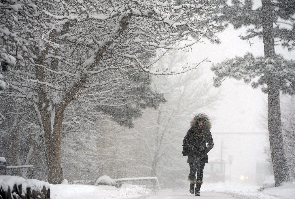 . A spring snowstorm, dumping about four inches so far, took many by surprise as huge flakes covered trees, roadways and cars.   Students on the University of Colorado campus in Boulder, CO make their way to and from school on April 15, 2013.(Photo By Helen H. Richardson/ The Denver Post)