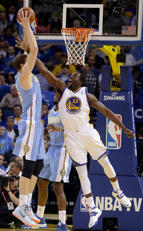. Golden State Warriors\' Draymond Green, right, attempts to block the shot of Denver Nuggets\' Timofey Mozgov during the first half of an NBA basketball game Thursday, April 10, 2014, in Oakland, Calif. (AP Photo/Ben Margot)