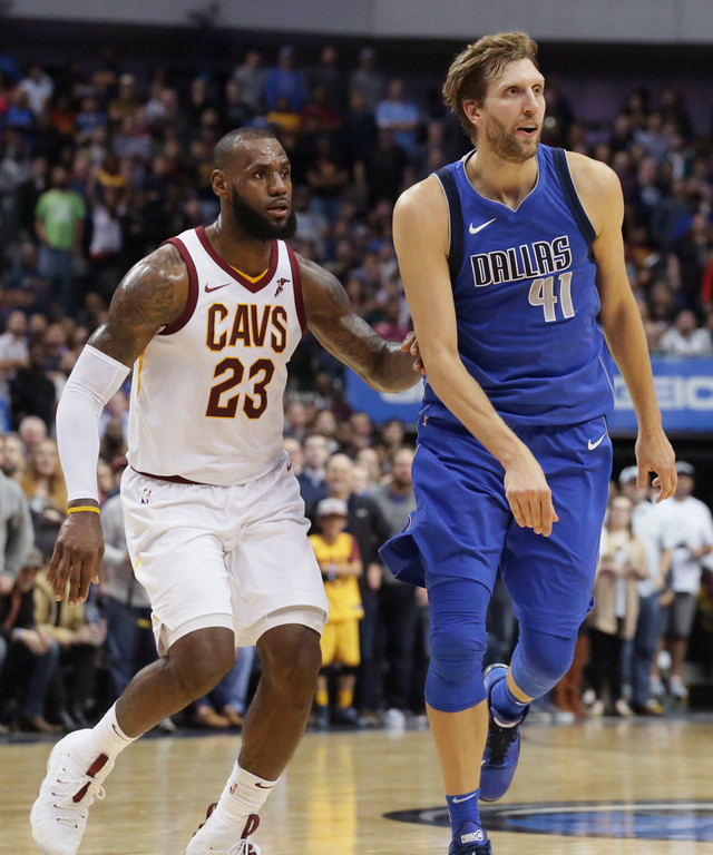 . Dallas Mavericks forward Dirk Nowitzki (41) of Germany and Cleveland Cavaliers forward LeBron James (23) play during the second half of an NBA basketball game in Dallas, Saturday, Nov. 11, 2017. (AP Photo/LM Otero)