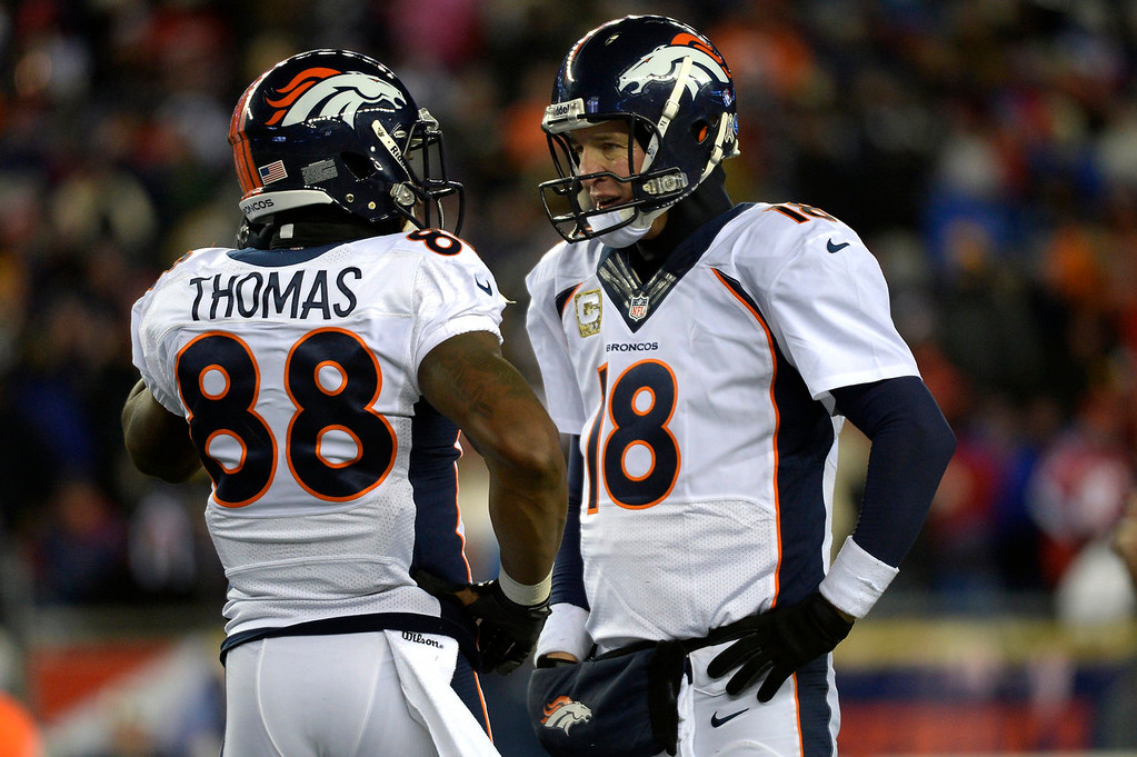 . Quarterback Peyton Manning #18 of the Denver Broncos talks with wide receiver Demaryius Thomas #88 after having to call a time out late in the game against the New England Patriots at Gillette Stadium in Foxborough MA, November 24, 2013 Denver. (Photo By Joe Amon/The Denver Post)