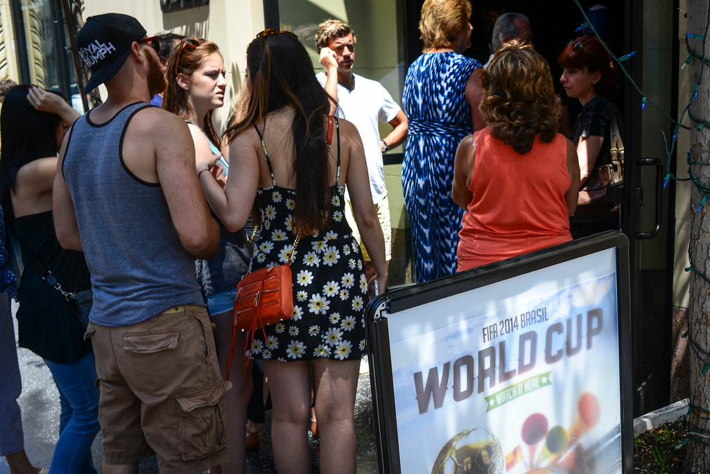 . Fans crowd to enter 33 Tap\'s Sport Bar in Hollywood, CA to watch the world cup final Sunday, July 13. 2014.  Germany defeated Argentina 1-0 to win the 2014 World Cup. ( Photo by David Crane/Los Angeles Daily News )