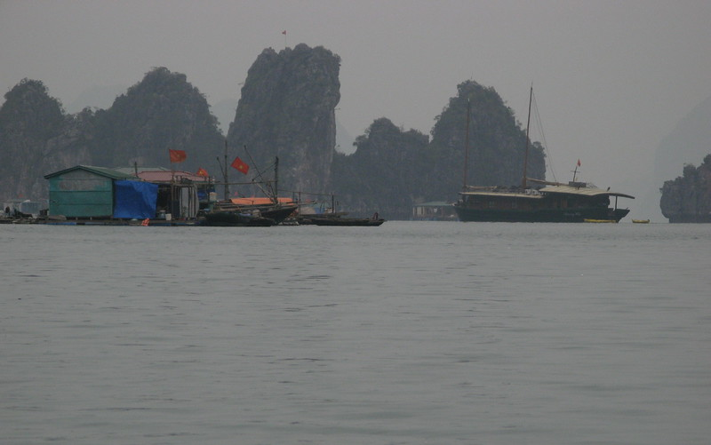 Our junk and the floating fishing village.