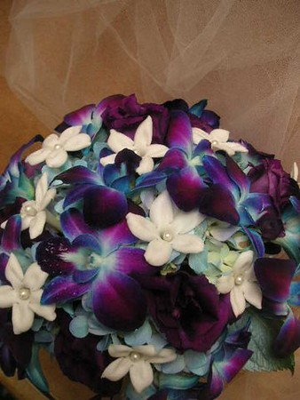 Blue orchids, stephanotis with pearls- $145 all wired