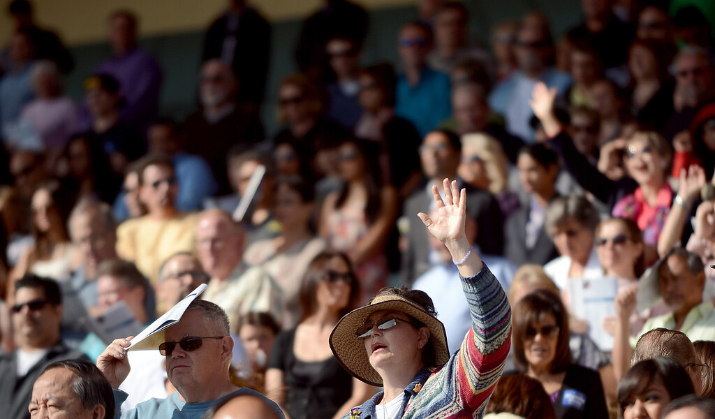 . Worshipers fill the grand stand at the Pomona First Baptist Church 17th annual regional Easter service at the Fairplex in Pomona March 31, 2013.(Thomas R. Cordova/Staff Photographer)