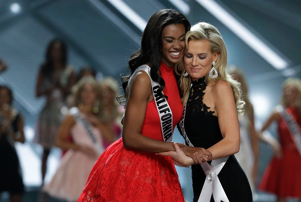 . Miss California USA India Williams, left, and Miss Tennessee USA Allee-Sutton Hethcoat embrace after making the top 10 during the Miss USA contest Sunday, May 14, 2017, in Las Vegas. (AP Photo/John Locher)