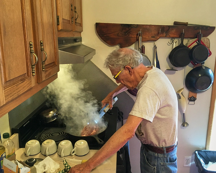 Larry Lebin cooking cast iron steaks. Sept 2 2016