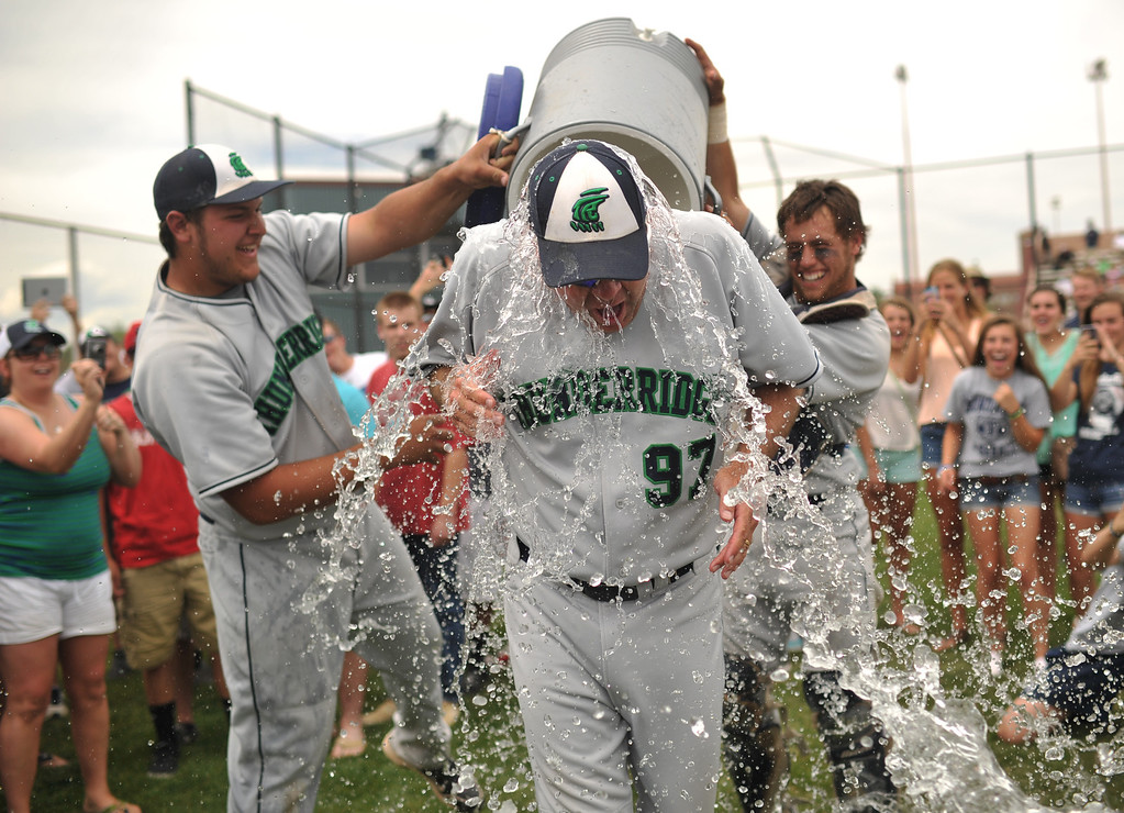 . DENVER, CO. - MAY 25: Josh Predolich (42), left, and Jake Hand (8), right, pour the water on Head Coach Joe White (97) of ThunderRidge HIgh School after winning 5A baseball state championship game against Rocky Mountain High School at All City Field. Denver, Colorado. May 25, 2013. ThunderRidge won 2-1. (Photo By Hyoung Chang/The Denver Post)