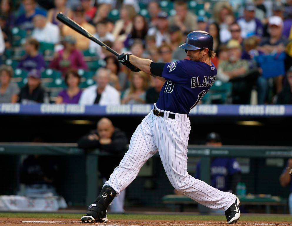 . Colorado Rockies\' Charlie Blackmon doubles against the Arizona Diamondbacks in the first inning of a baseball game in Denver on Saturday, Sept. 21, 2013. (AP Photo/David Zalubowski)