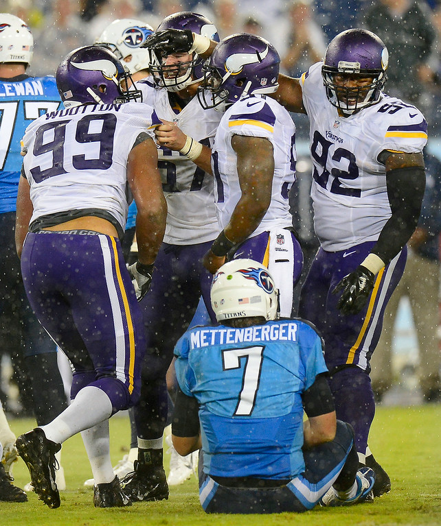 . Tennessee Titans quarterback Zach Mettenberger sits on the turf after Minnesota Vikings defensive tackle Corey Wootton (99) sacked Mettenberger and stripped the ball away in second-quarter action. (AP Photo/Mark Zaleski)