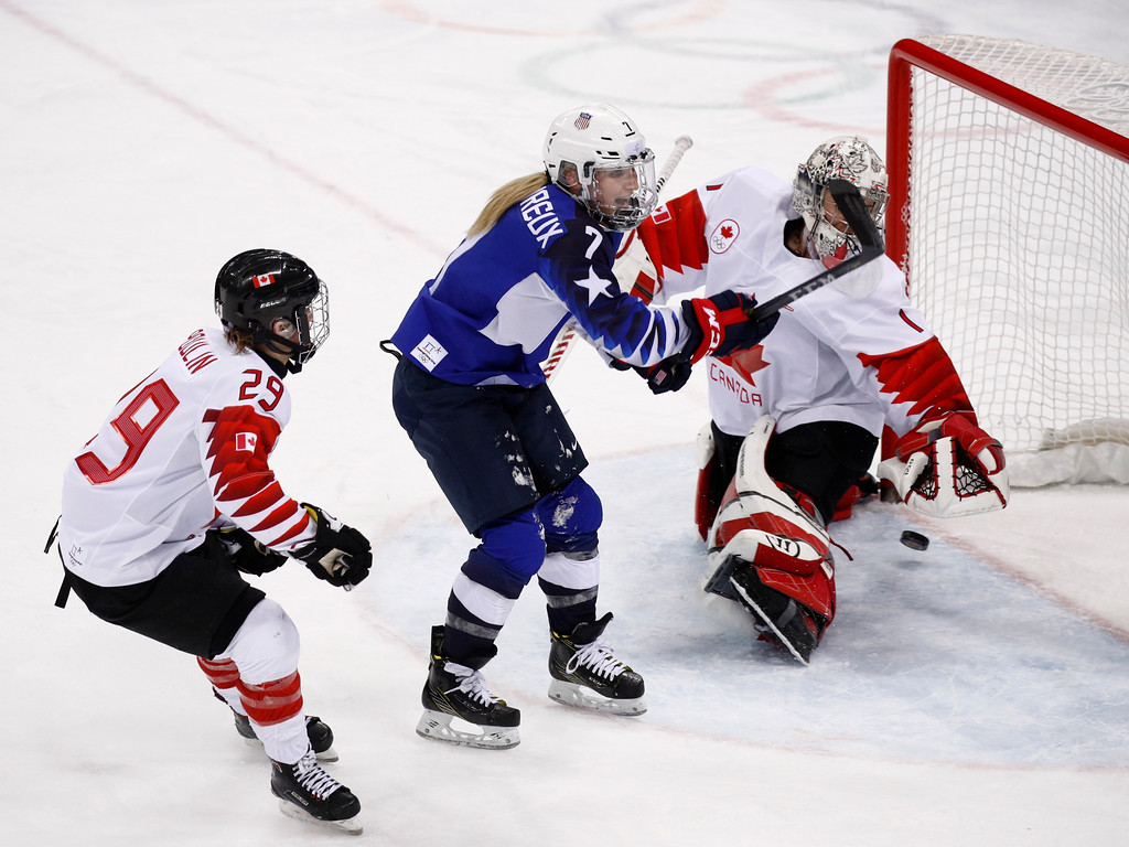 . Monique Lamoureux-Morando (7), of the United States, shoot the puck past goalie Shannon Szabados (1), of Canada, for as goal during the third period of the women\'s gold medal hockey game at the 2018 Winter Olympics in Gangneung, South Korea, Thursday, Feb. 22, 2018. (AP Photo/Jae C. Hong)