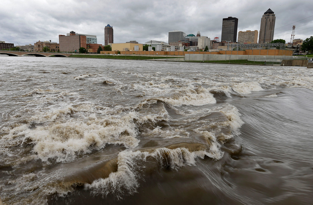 . n this May 30, 2013, file photo, water splashes over the Center Street Dam in the swollen Des Moines River in downtown Des Moines, Iowa.  (AP Photo/Charlie Neibergall, File)