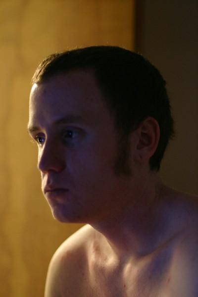 Brendan broods silently in the dark