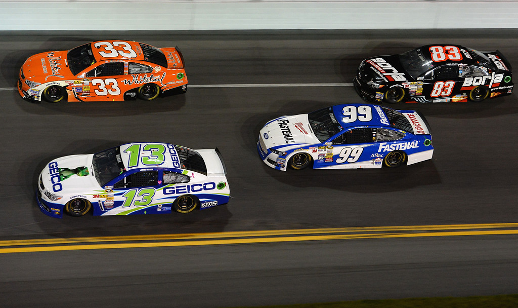 . Brian Scott, driver of the #33 Whitetail Chevrolet, Casey Mears, driver of the #13 GEICO Ford, Carl Edwards, driver of the #99 Fastenal Ford, and Ryan Truex, driver of the #83 Borla Exhaust Toyota, race during the NASCAR Sprint Cup Series Budweiser Duel 2 at Daytona International Speedway on February 20, 2014 in Daytona Beach, Florida.  (Photo by Robert Laberge/Getty Images)