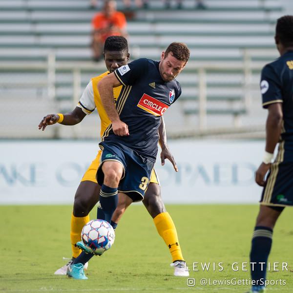 Nashville SC forward Ropapa Mensah (3) and North Carolina FC defender Steven Miller (31)
