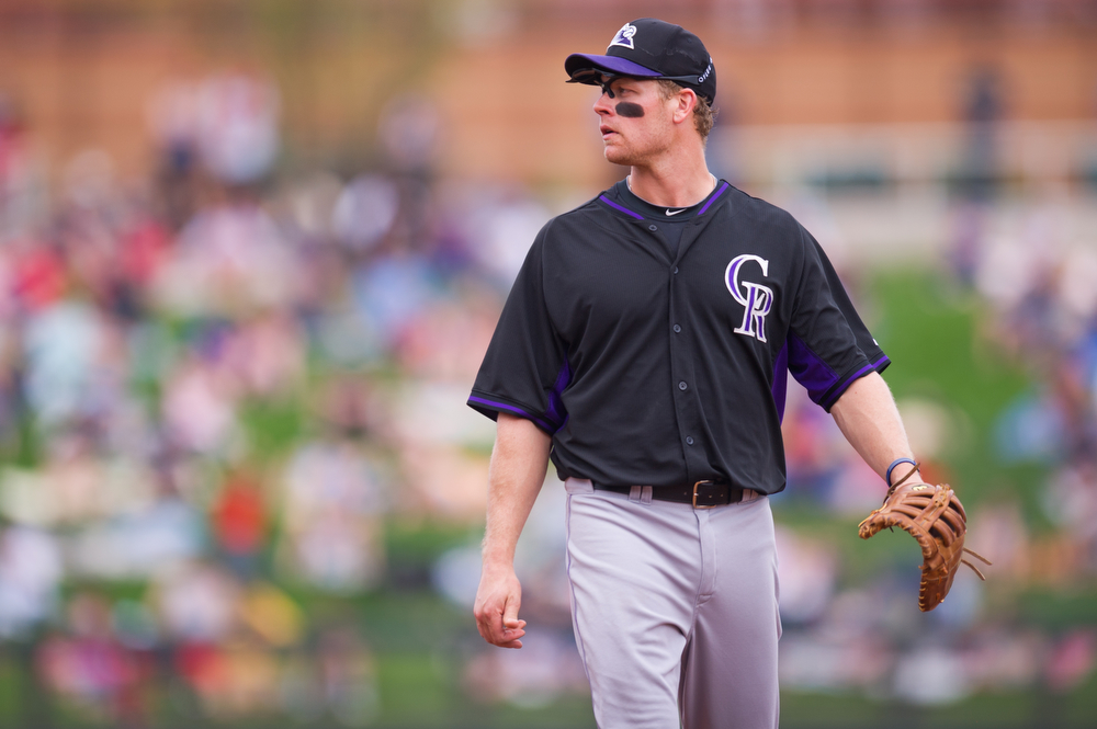 . Justin Morneau #33 of the Colorado Rockies looks on during a spring training game against the Arizona Diamondbacks at Salt River Fields at Talking Stick on February 28, 2014 in Scottsdale, Arizona. (Photo by Rob Tringali/Getty Images)