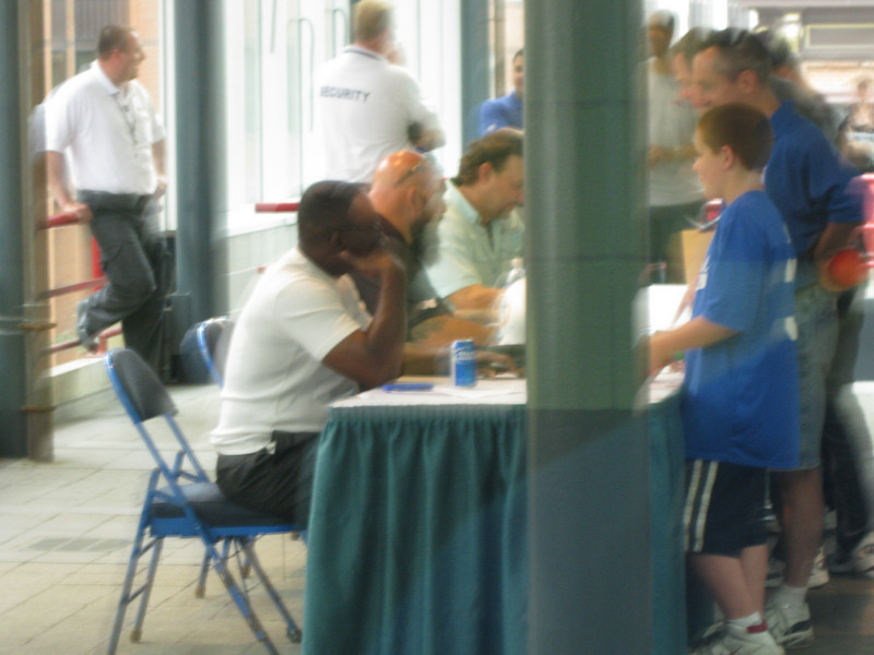 Former NFL players Mark Duper and Jim Jensen of the Miami Dolphins were having an autograph session.