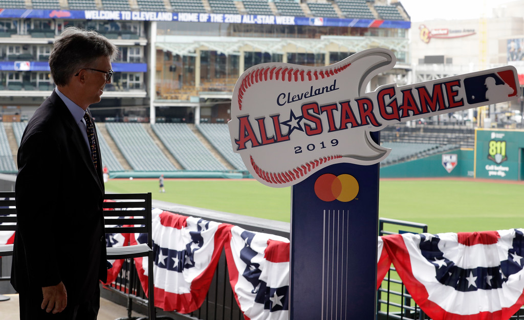 . Cleveland Indians owner Paul Dolan looks at the 2019 All-Star Game logo, Tuesday, Aug. 7, 2018, in Cleveland. Indians took the rock \'n\' roll route with a logo for the 2019 All-Star Game that won\'t offend anyone. The Indians are hosting the event for the sixth time, and next year\'s game coincides with the 25th anniversary of Progressive Field. (AP Photo/Tony Dejak)