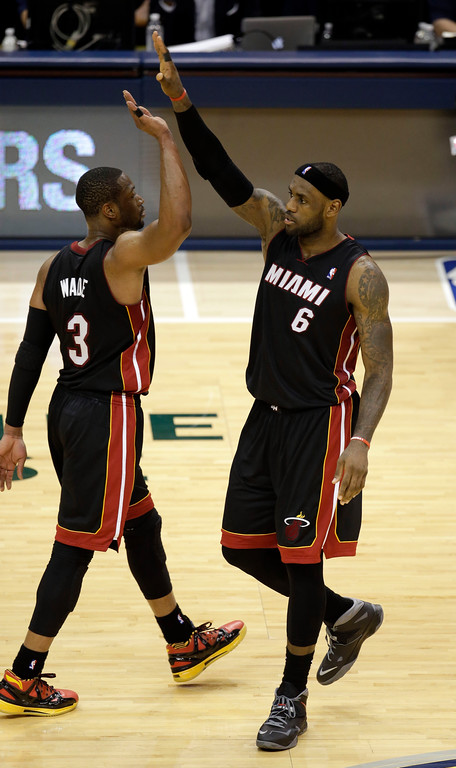 . Miami Heat forward LeBron James (6) high-fives teammate Dwyane Wade (3) late in the second half of Game 2 of the NBA basketball Eastern Conference finals against the Indiana Pacers in Indianapolis, Tuesday, May 20, 2014. The Heat won 87-83. (AP Photo/AJ Mast)