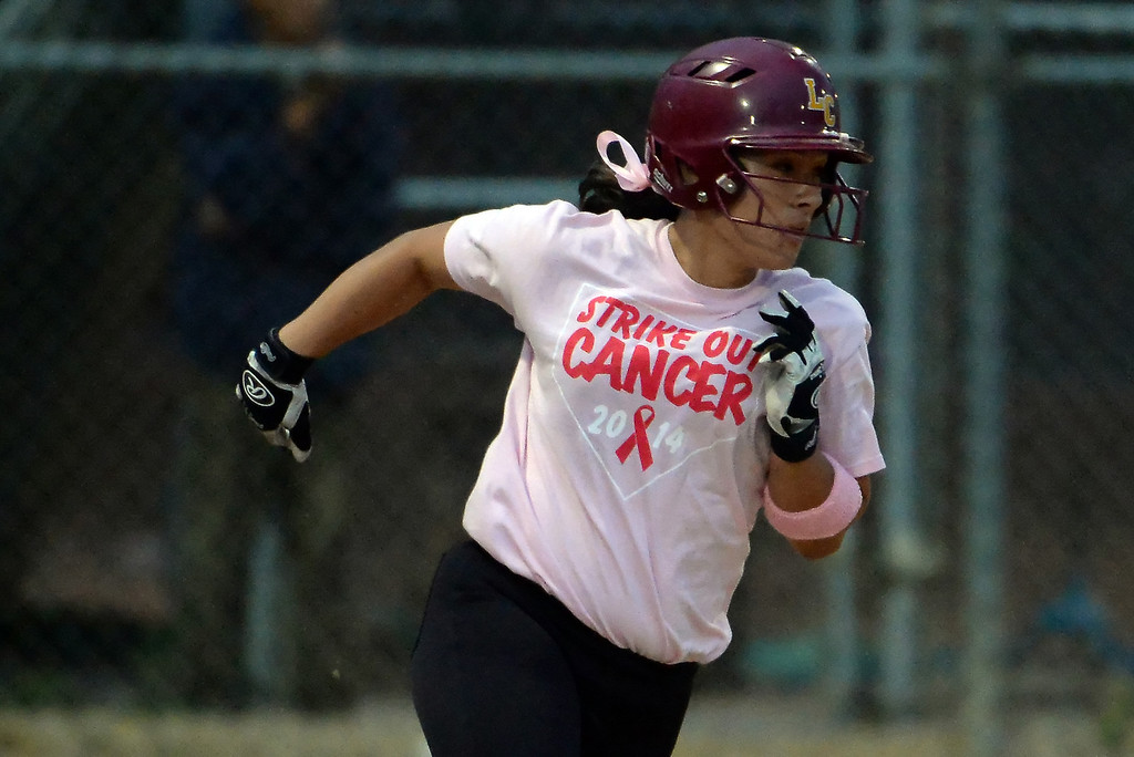 . La Canada\'s Olivia Lam singles in the first inning of a prep softball game against Monrovia at La Canada High School in La Canada, Calif., on Friday, April 25, 2014.  (Keith Birmingham Pasadena Star-News)